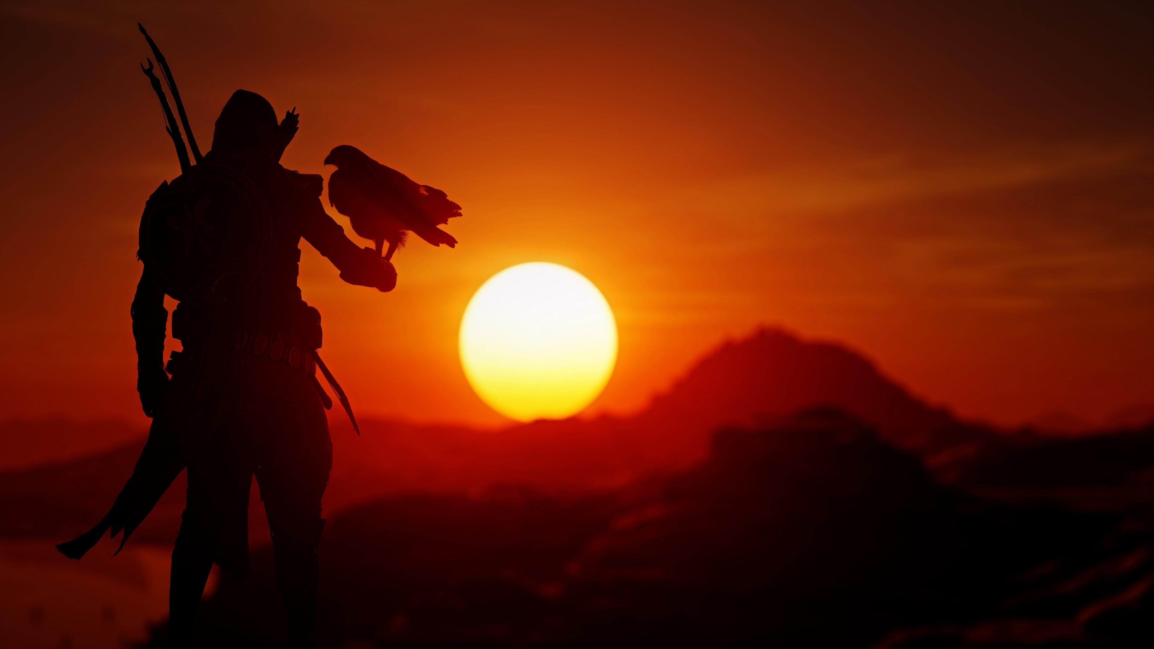 Воин с оружием и орлом на фоне красного заката лучей солнца