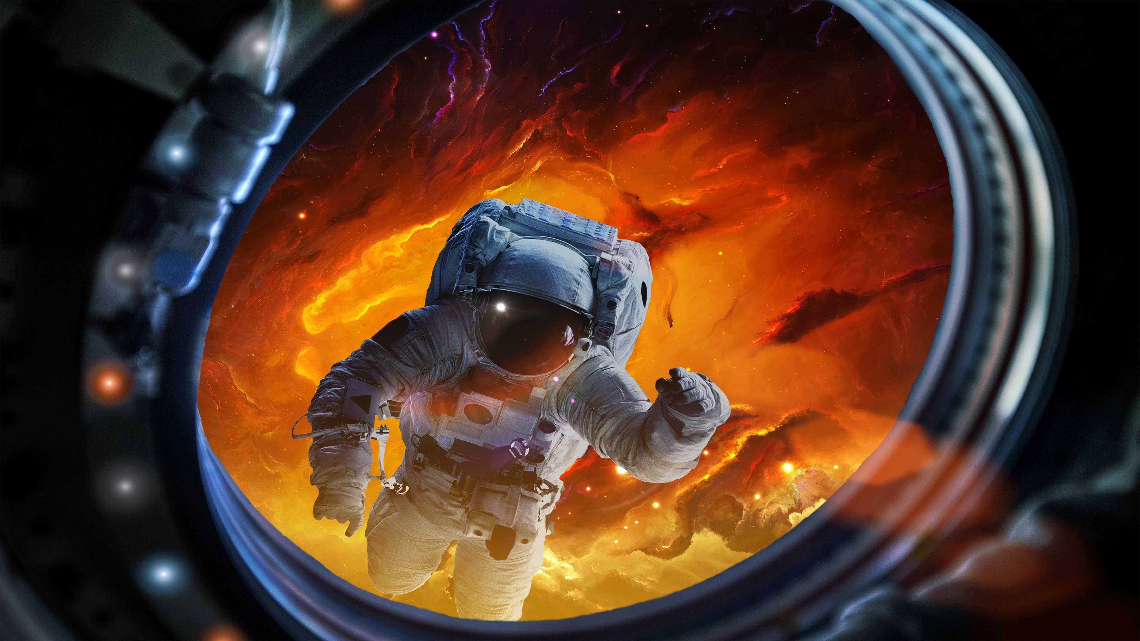 Земля в иллюминаторе космического корабля с космонавтом