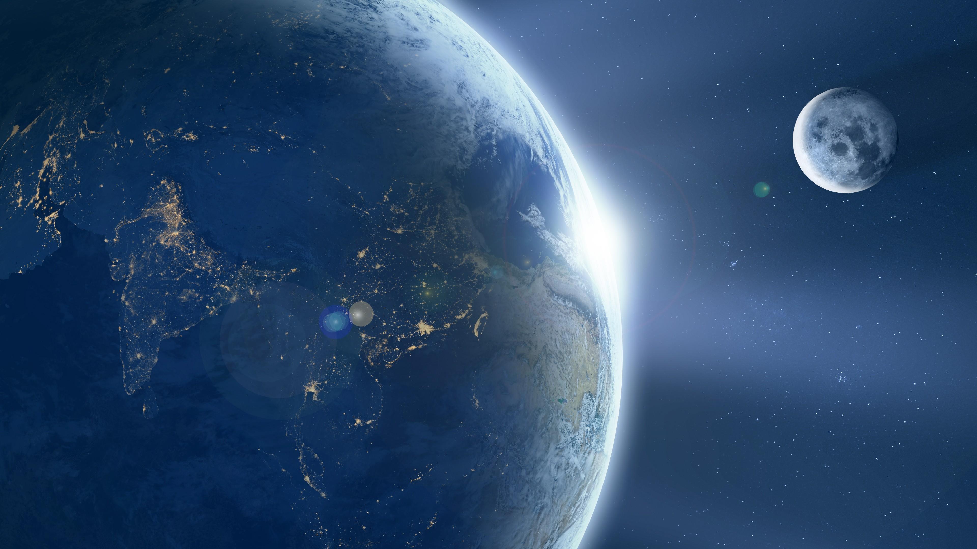 Голубая планета и ее единственный спутник Луна в космосе