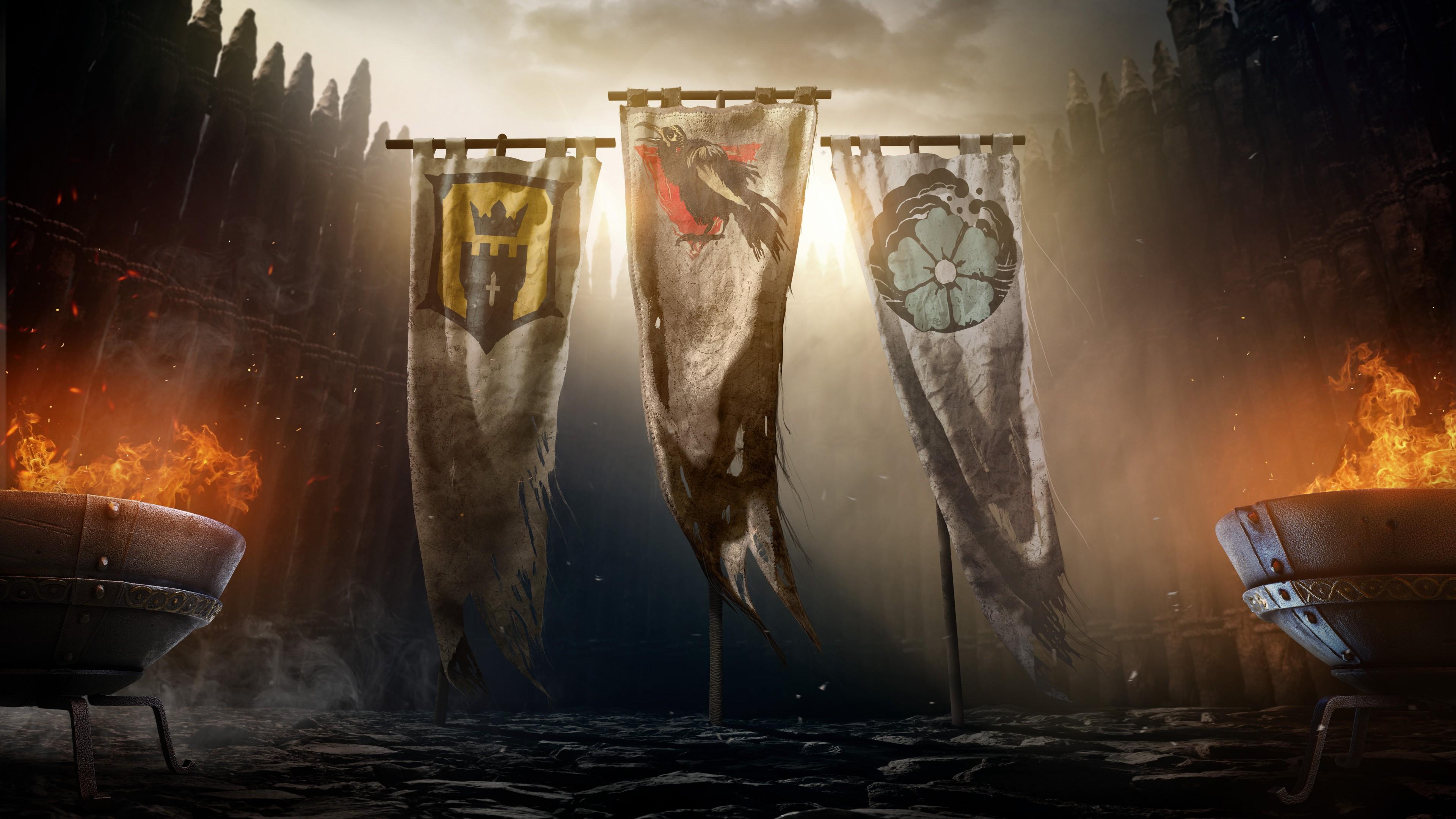 Три флага среди чугунных котлов с огненными языками пламени и искрами