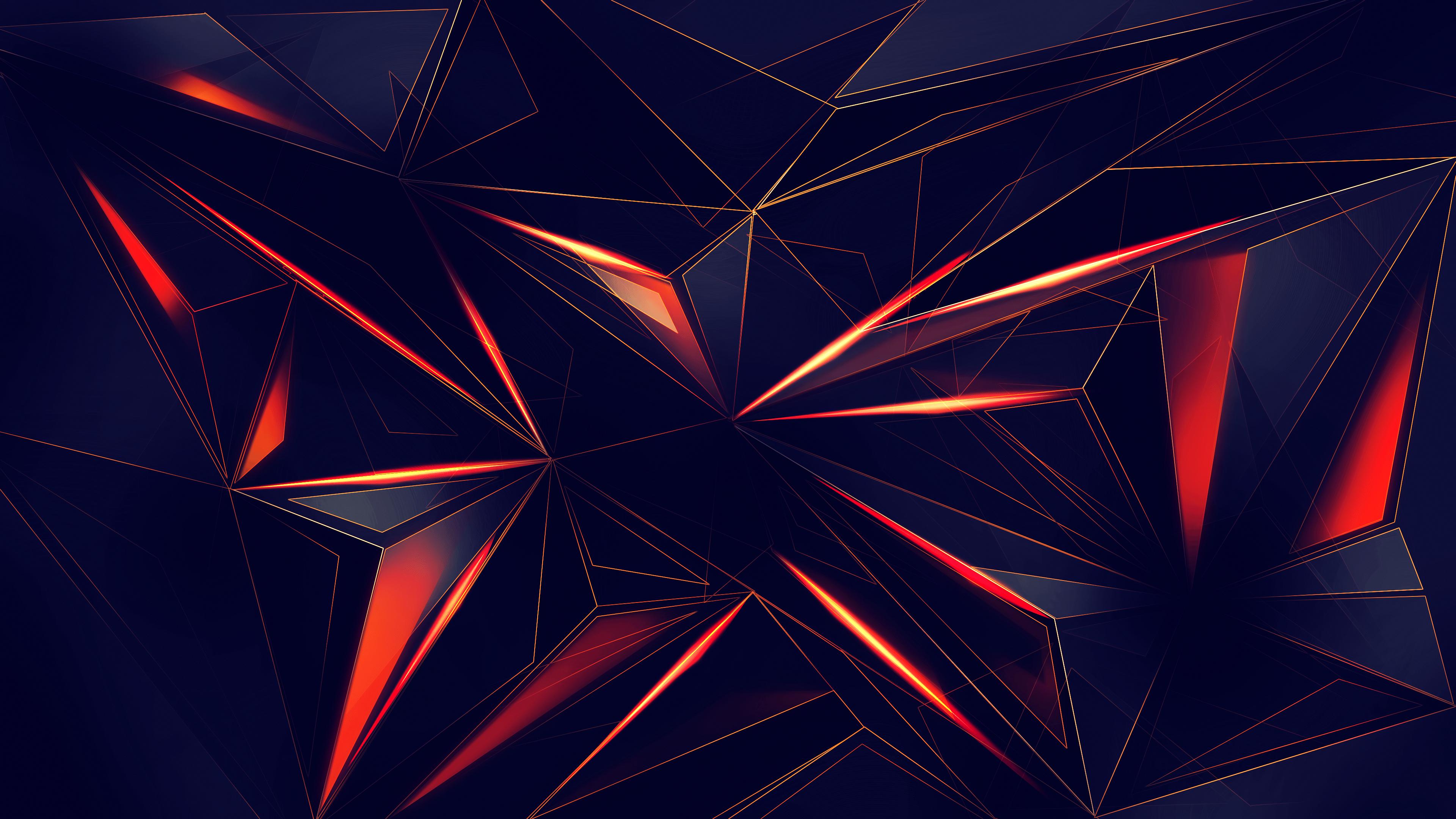 Темно-синии геометрические фигуры в красно-желтых отблесках света