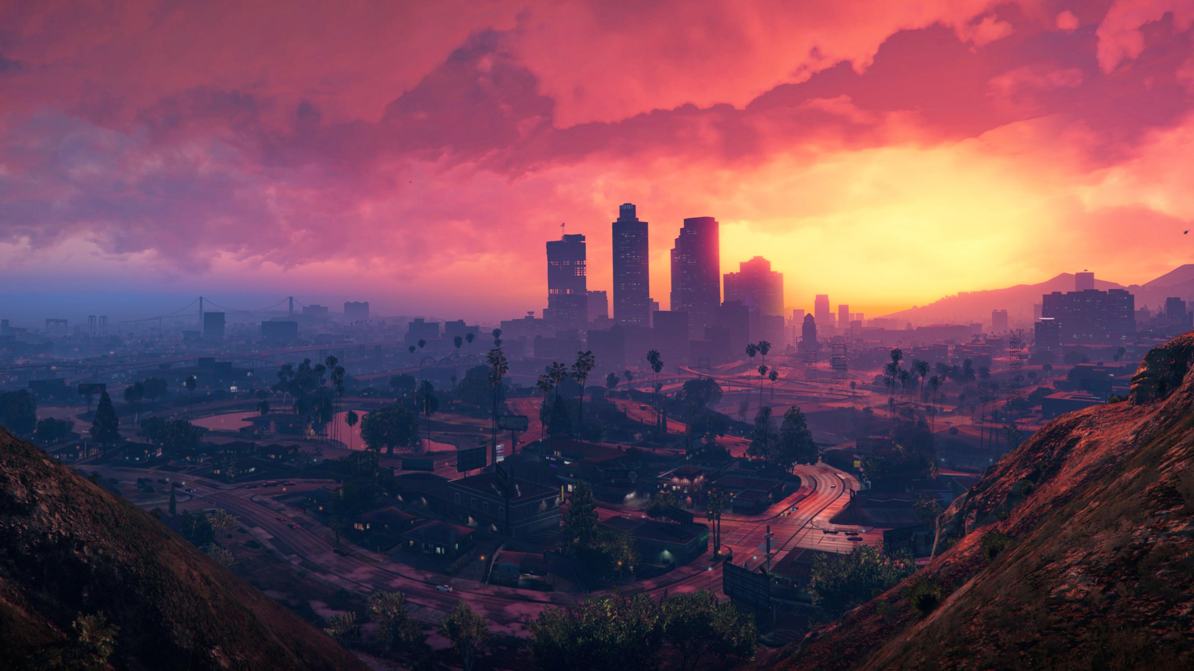 Ночной город небоскребов в огненных лучах заката